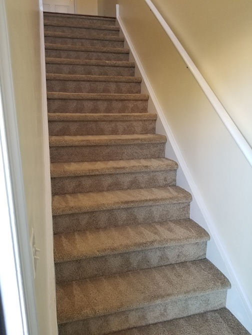 tan carpeted stairs